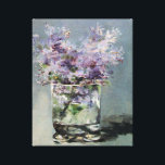 """Lilacs in a Glass  by Edouard Manet Canvas Print<br><div class=""""desc"""">&quot;Lilacs in a Glass&quot; was painted by Edouard Manet during his last months of life (1882- 1883). This small painting was one of 16 small size flower paintings he created from the flowers friends gave him when they visited him during his illness. He placed the flowers in unique glass and...</div>"""