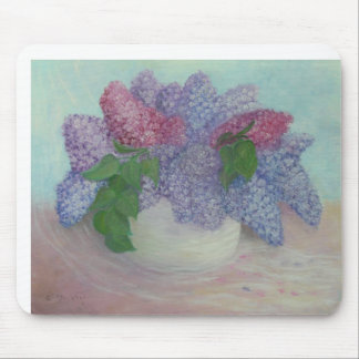 Lilas en un florero tapete de raton