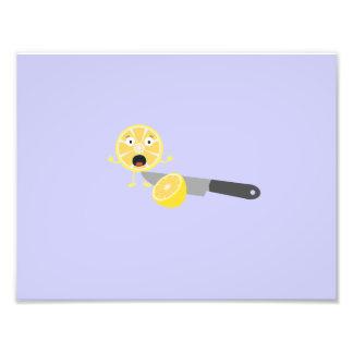Limón con el cuchillo fotografía