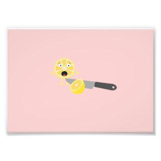 Limón con el cuchillo fotografías