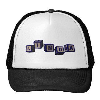 Linda toy blocks in blue trucker hat