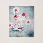 Lindo rosado femenino de la rana rompecabeza