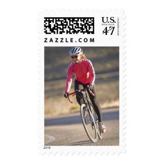 Lindsey Bishop road biking, Boulder, Colorado. Postage