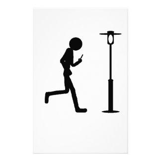Line man runs in lantern stationery
