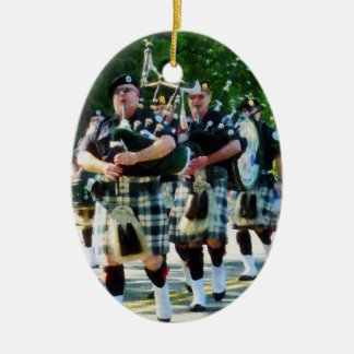 Line Of Bagpipers Double-Sided Oval Ceramic Christmas Ornament