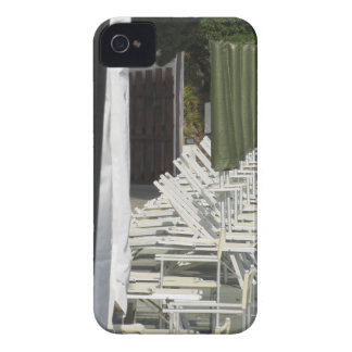 Line of closed beach chairs and umbrellas iPhone 4 case