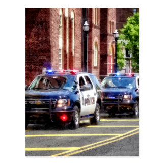 Line of Police Cars Postcard