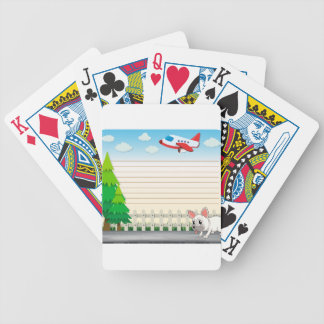 Line paper desing with dog on sidewalk bicycle playing cards