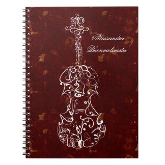Línea blanca violín en el cuaderno espiral rojo
