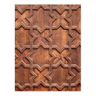 Líneas abstractas simétricas del modelo en madera postales