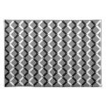 Líneas blancos y negros traslapadas del zigzag mantel