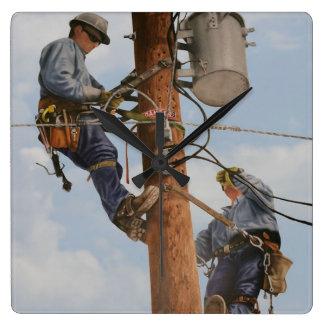 lineman team working in pole clock