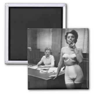 Lingerie model smoking in an office magnet