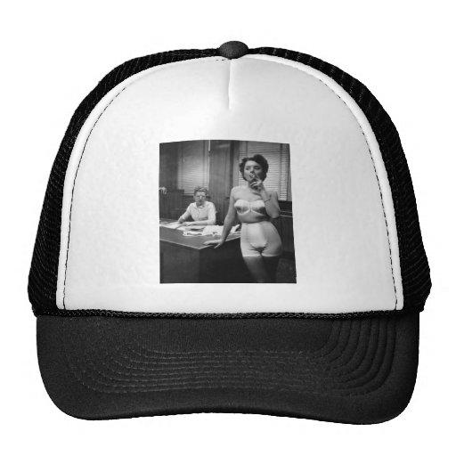 Lingerie model smoking in an office mesh hat
