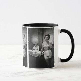 Lingerie model smoking in an office mug