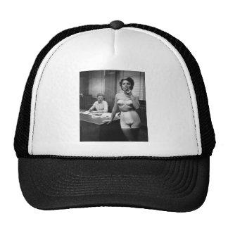 Lingerie model smoking in an office trucker hat