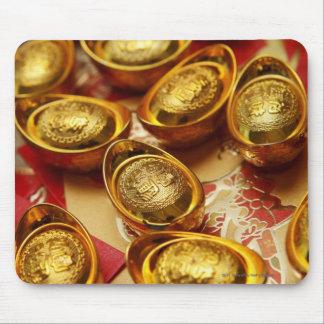 Lingotes chinos del oro tapete de ratones