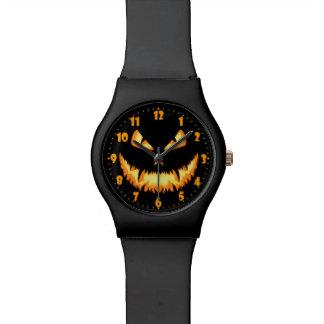 Linterna de Jack O con una mueca malvada y Reloj