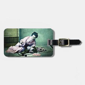 Linterna mágica japonesa del vintage de la madre y etiqueta para maleta