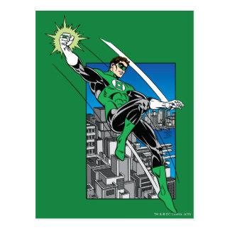 Linterna verde con el fondo de la ciudad tarjetas postales