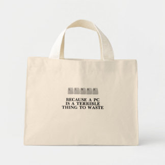 Linux, because a PC is a terrible thing to waste Tote Bags