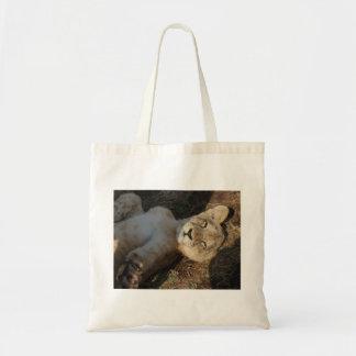 Lion cub stretching tote bag