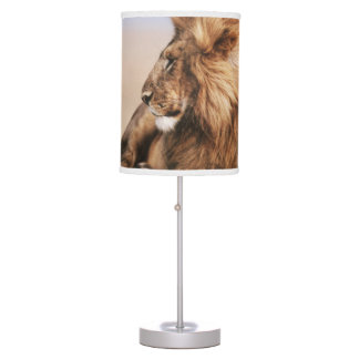 Lion resting in grass table lamps