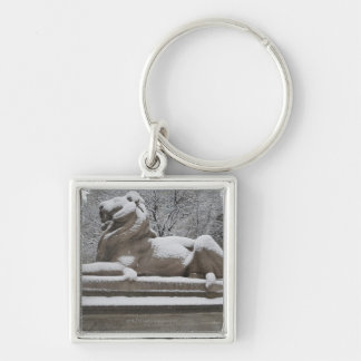 Lion sculpture covered in snow keychain