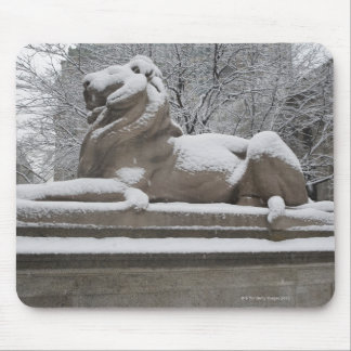 Lion sculpture covered in snow mouse pad