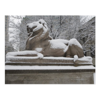 Lion sculpture covered in snow postcard