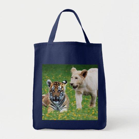 Lion & tiger cubs at play tote bag