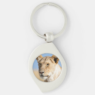 Lioness against blue sky keychain
