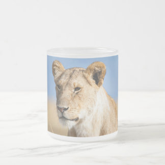 Lioness against blue sky 10 oz frosted glass coffee mug