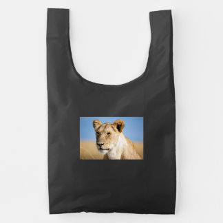 Lioness against blue sky reusable bag