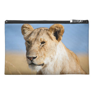 Lioness against blue sky travel accessory bags
