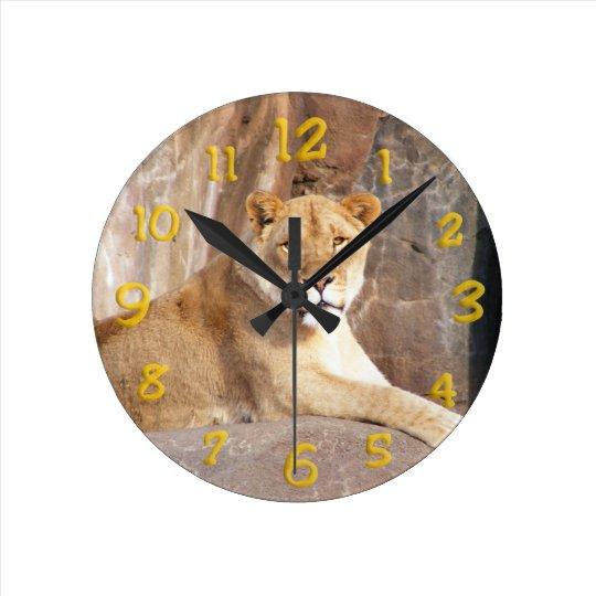 Lioness on the Rocks Round Clock