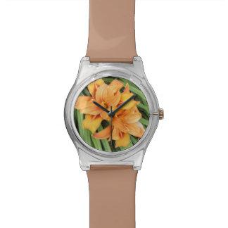 Lirios anaranjados reloj