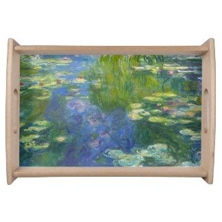Lirios de agua de Monet que sirven la bandeja