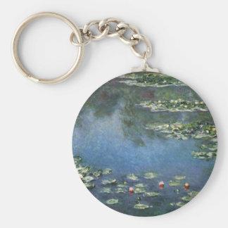 Lirios de agua por impresionismo floral del llavero redondo tipo chapa