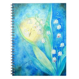 Lirios del valle con la mariposa notebook