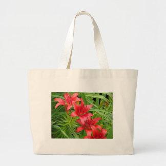 Lirios rojos bolsas de mano