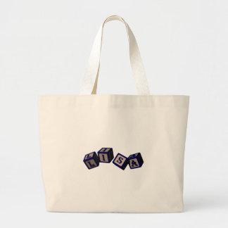 Lisa toy blocks in blue tote bags