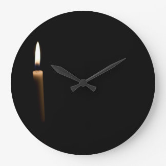 Lit candle wall clock