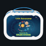 """Little Astronomer Blue Lunch Box<br><div class=""""desc"""">The art on this lunch box is from the Little Astronomer: Journey Into The Solar System From The Sun To Eris,  an information picture book for kids. It explores the solar system with the eight planets,  asteroids,  moons and dwarf planets.</div>"""