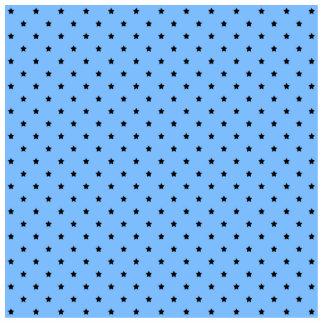 Little black stars on a light blue background. cutout