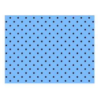 Little black stars on a light blue background. postcard