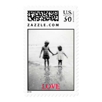Little boy and girl holding hands...in love postage