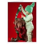 Little boy decorating a dog greeting card
