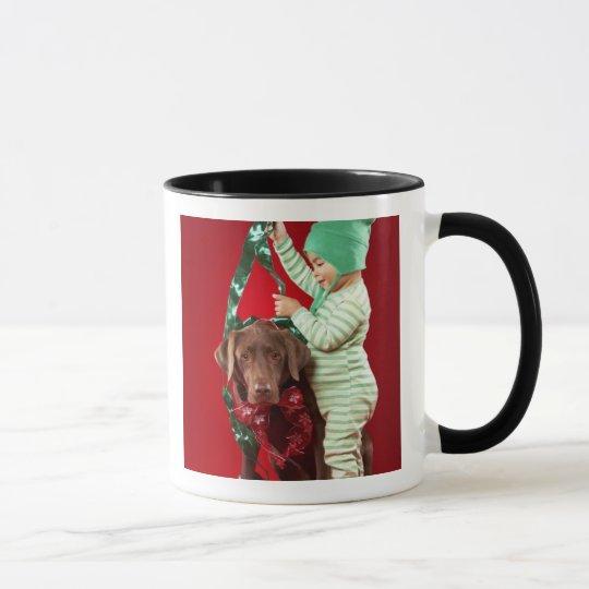 Little boy decorating a dog mug