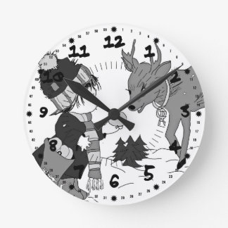 Little boy feeding reindeer in black and white wall clock
